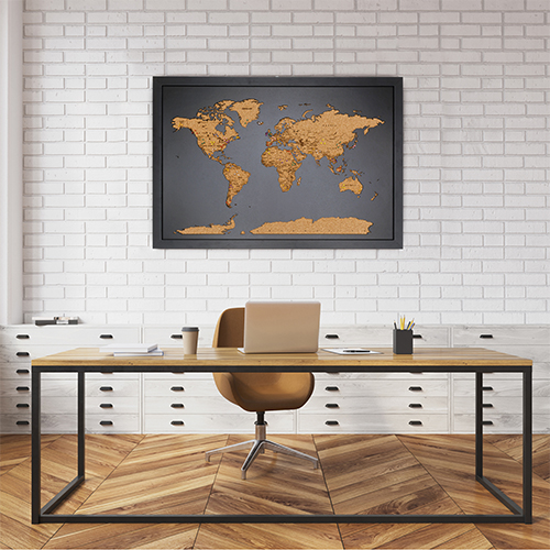 home decor map mounted on the wall behind desk in home office
