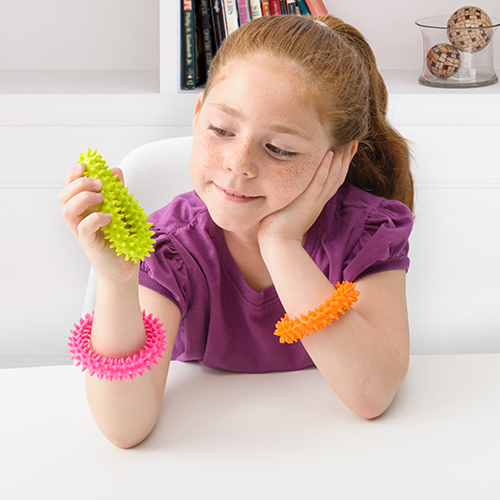 young girl trying out bracelet toys