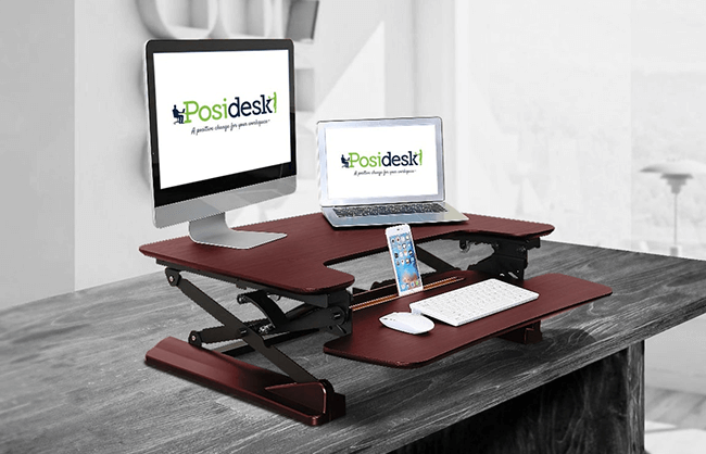 Lifestyle image of a laptop stand on a desk
