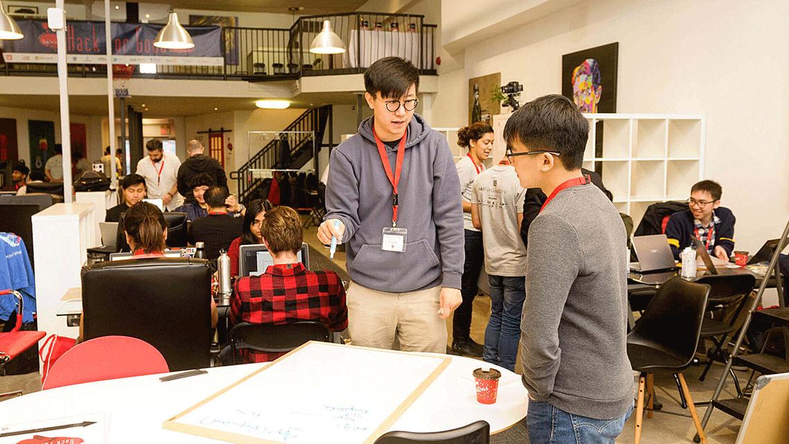 Participants collaborating at geekspeak's Hack for Good Hackathon