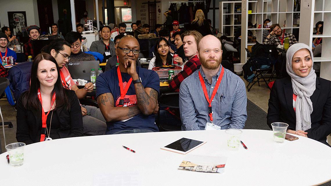 Judges listening to presentations at geekspeak's Hack for Good Hackathon