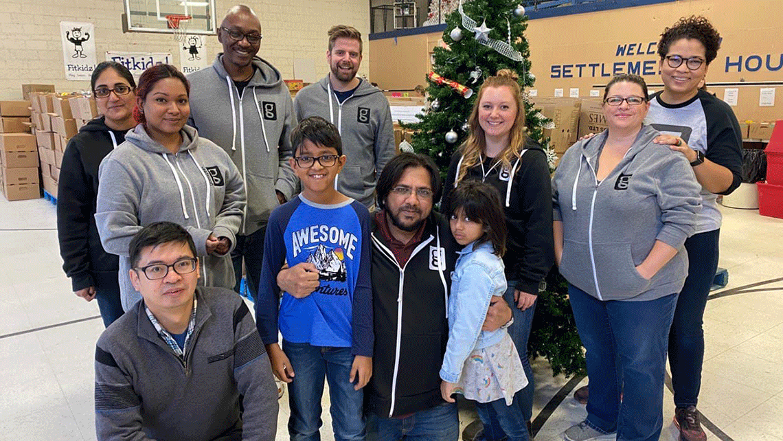geekspeak team members and family volunteering at the Simcoe Settlement House