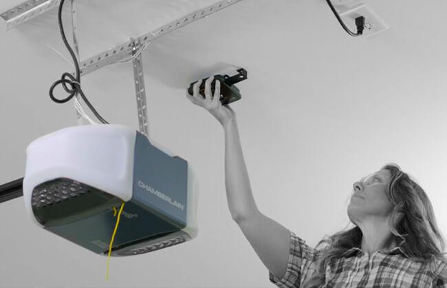 Woman installing garage censor