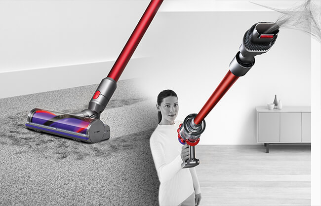 Woman using Dyson vacuum on floor and on ceiling