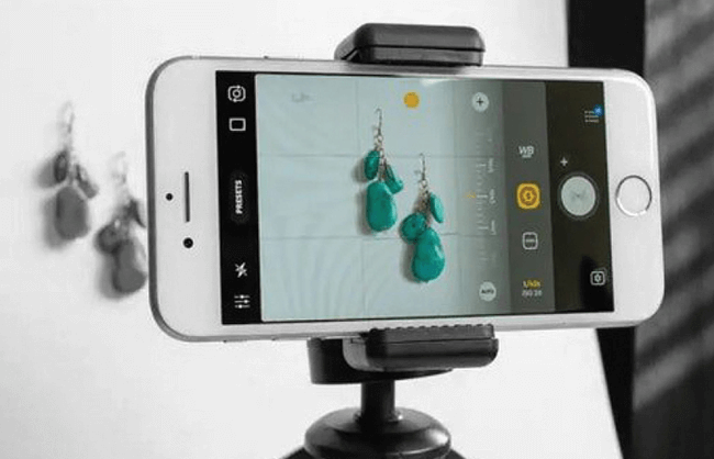 Image of smart phone on tripod in a studio