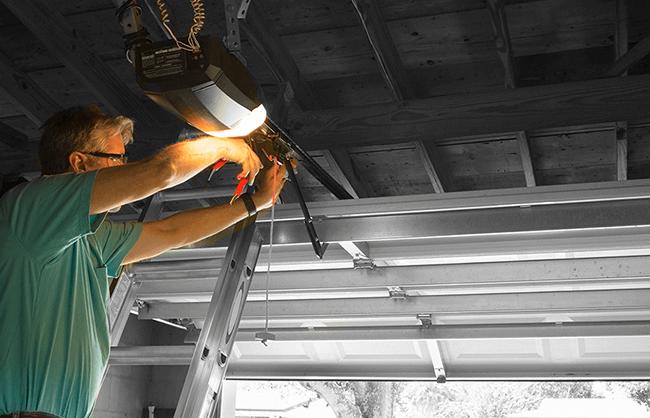 Man installing garage light