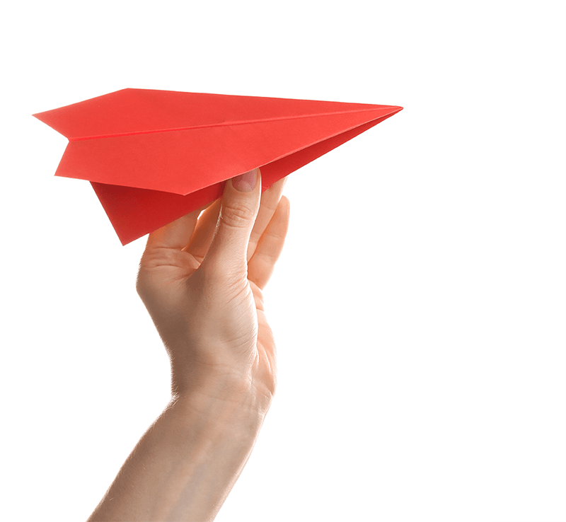 hand throwing paper airplane