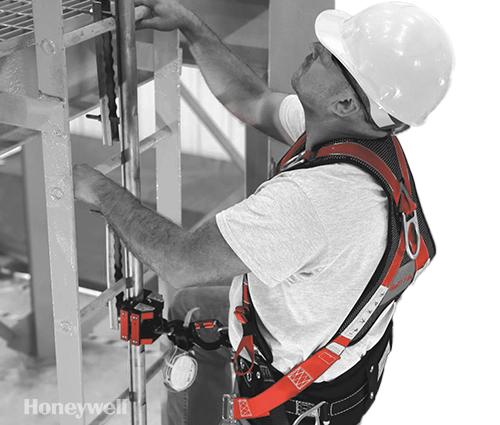 Man wearing Honeywell harness and working