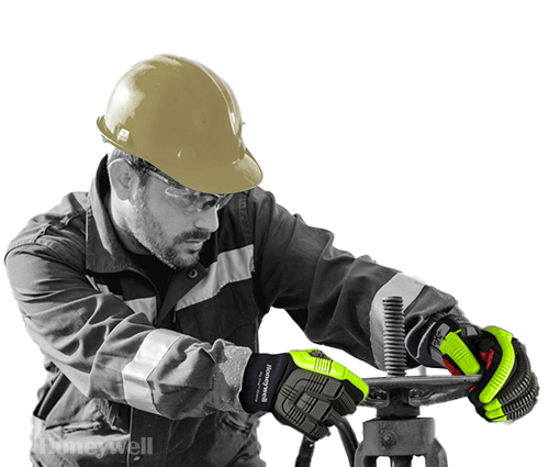 Man in hard hat using a tool with wearing Honeywell work gloves