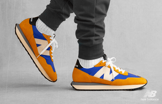 Close up New Balance shoes on walking man