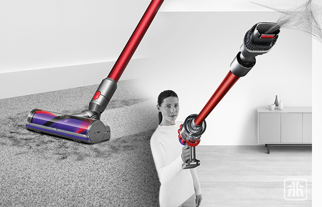 Woman using dyson vacuum on floor and ceiling